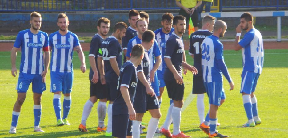 Avramovski and others wait for a free kick
